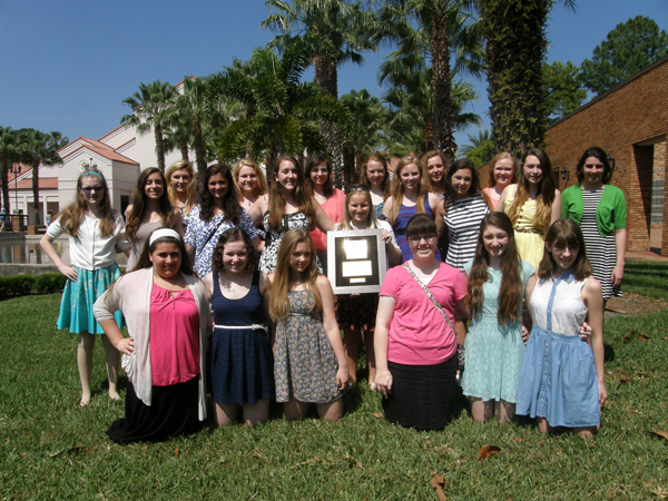 Mercy's Pure Magic Show Choir pictured here with their gold award from the Heritage Music Festival