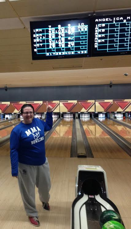 Senior bowler Rachael Howard proudly points to her impressive `turkey`.