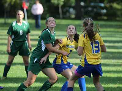 Jackie Kane fights for the ball against Nichols. (photo by Jeff Barnes of Metro Source)