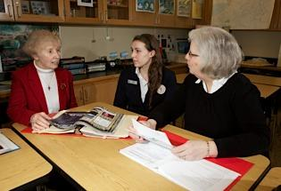 Sister Mary Ellen Twist, left, president of Mount Mercy Academy, discusses the school's Academy of Science and Healthcare, with student Lauran Pantano and academy coordinator Candace Wagner. The school exposes students to health-care careers, thanks to a partnership with Catholic Health System. photo by: Jim Courtney