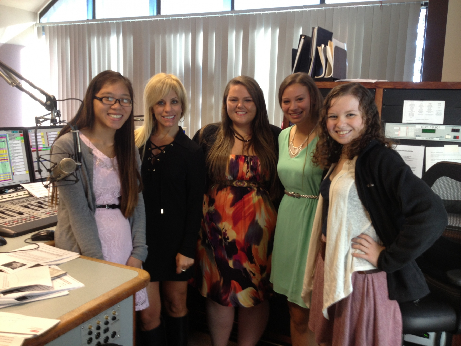 Students pictured here with Janet Snyder from Kiss 98.5